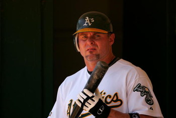 OAKLAND, CA - JUNE 28:  Jason Giambi #16 of the Oakland Athletics stands in the dugout during their game against the Colorado Rockies at the Oakland Coliseum on June 28, 2009 in Oakland, California.  (Photo by Ezra Shaw/Getty Images)