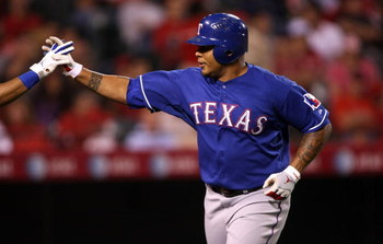 ANAHEIM, CA - JULY 08:  Andruw Jones #25 of the Texas Rangers celebrates after hitting his third home run of the game against the Los Angeles Angels of Anaheim in the fifth inning at Angel Stadium July 8, 2009 in Anaheim, California.  (Photo by Stephen Du
