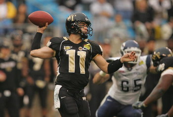 CHARLOTTE, NC - DECEMBER 29:  Riley Skinner #11 of the Wake Forest Demon Deacons throws a pass against the Connecticut Huskies during their game at Bank of America Stadium on December 29, 2007 in Charlotte, North Carolina. (Photo by Streeter Lecka/Getty I