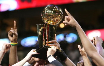 DALLAS - JUNE 20:  The Miami Heat hold up the Larry O'Brien trophy after they defeated the Dallas Mavericks in game six of the 2006 NBA Finals on June 20, 2006 at American Airlines Center in Dallas, Texas.  The Heat won 95-92 and win the series 4-2.  NOTE