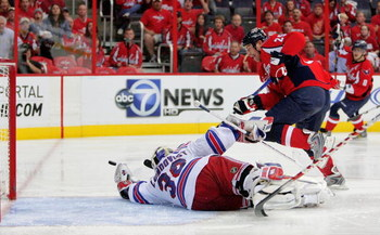 WASHINGTON - APRIL 28:  Viktor Kozlov #25 of the Washington Capitals takes a shot on goal against Henrik Lundqvist #30 of the New York Rangers during Game Seven of the Eastern Conference Quarterfinal Round of the 2009 Stanley Cup Playoffs on April 28, 200
