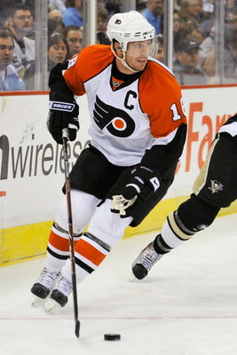 PITTSBURGH - APRIL 17:  Forward Mike Richards #18 of the Philadelphia Flyers skates with the puck against the Pittsburgh Penguins during Game Two of the Eastern Conference Quarterfinals of the 2009 Stanley Cup Playoffs on April 17, 2009 at Mellon Arena in
