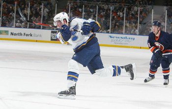 UNIONDALE, NY - MARCH 1:  David Backes #42 of the St. Louis Blues shoots the puck against the New York Islanders on March 1, 2007 at Nassau Coliseum in Uniondale, New York. The Blues won 3-2 in overtime. (Photo by Jim McIsaac/Getty Images)