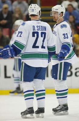 DETROIT - JANUARY 17:  The Sedin brothers Daniel #22 and Henrik #33 of the Vancouver Canucks chat prior to a faceoff in a game against the Detroit Red Wings on January 17, 2008 at the Joe Louis Arena in Detroit, Michigan. The Wings defeated the Canucks 3-