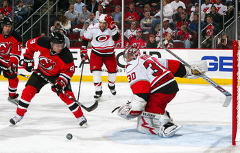 NEWARK, NJ - APRIL 23:  Cam Ward #30 of the Carolina Hurricanes denies a scoring chance by Zach Parise #9 of the New Jersey Devils during Game Five of the Eastern Conference Quarterfinal Round of the 2009 NHL Stanley Cup Playoffs on April 23, 2009 at the