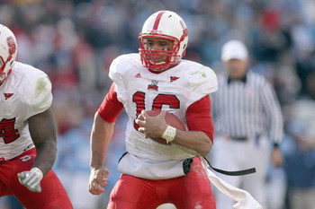 CHAPEL HILL - NOVEMBER 22:   Quarterback Russell Wilson #16 of the North Carolina State Wolfpack runs the ball during the game against the North Carolina Tar Heels at Kenan Stadium on November 22, 2008 in Chapel Hill, North Carolina. ( Photo by: Streeter