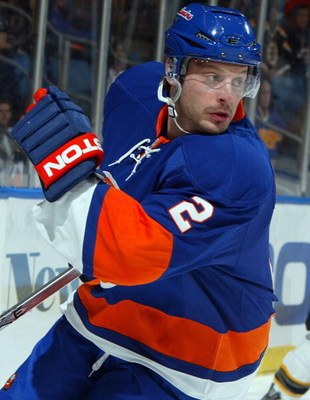 UNIONDALE, NY - APRIL 12:  Mark Streit #2 of the New York Islanders skates against the the Boston Bruins on April 12, 2009 at Nassau Coliseum in Uniondale, New York. The Bruins won the game 6-2.  (Photo by Jim McIsaac/Getty Images)