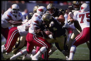 18 Oct 1992:  Running back Craig Heyward #34 of the New Orleans Saints crashes through the defensive line of the Arizona at Busch Stadium in Tempe, Arizona.  The Saints defeated the Cardinals 30-21.  Mandatory Credit:  Stephen Dunn/Allsport