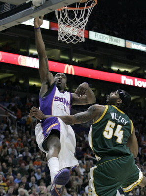 PHOENIX - FEBRUARY 8:  Amare' Stoudemire #1 of the Phoenix Suns lays the ball in against Chris Wilcox #54 of the Seattle SuperSonics on February 8, 2008 at US Airways Center in Phoenix, Arizona. NOTE TO USER: User expressly acknowledges and agrees that, b
