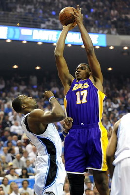 ORLANDO, FL - JUNE 14:  Andrew Bynum #17 of the Los Angeles Lakers shoots over Dwight Howard #12 of the Orlando Magic in the first quarter of Game Five of the 2009 NBA Finals on June 14, 2009 at Amway Arena in Orlando, Florida.  NOTE TO USER:  User expres