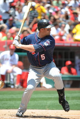 ANAHEIM, CA - JULY 26:  Michael Cuddyer #5 of the Minnesota Twins at bat against the Los Angeles Angels of Anaheim at Angels Stadium on July 26, 2009 in Anaheim, California. (Photo by Harry How/Getty Images