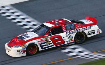 DAYTONA BEACH, FL - FEBRUARY 15: Dale Earnhardt, Jr. driver of the #8 Budweiser Chevrolet Monte Carlo, crosses the finish line on his way toward winning the Daytona 500 on February 15, 2004 at Daytona International Speedway in Daytona Beach, Florida.  (Ph