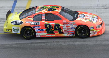 Top NASCAR Winston Cup series driver Jeff Gordon drives one of the 'NASCAR RACERS'-themed cars, unveiled Thursday, November 11th at the start of the Pennzoil 400 weekend at Homestead-Miami Speedway as NASCAR and the Fox Kids Network celebrated the premier