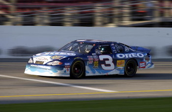Dale Earnhardt Jr. racing in the Nascar Busch Series EAS/GNC Live Well 300 in the #3 car at Daytona Speedway on Feb. 16, 2002. Photo by Gabe Palacio/ImageDirect