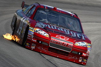 LONG POND, PA - AUGUST 01: Tony Stewart drives the #14 Old Spice Swagger Chevrolet during practice for the NASCAR Sprint Cup Series Sunoco Red Cross Pennsylvania 500 at the Pocono Raceway on August 1, 2009 in Long Pond, Pennsylvania.  (Photo by Chris McGr