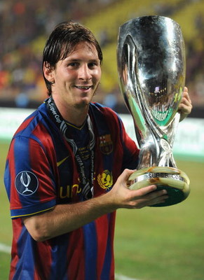 MONTE CARLO, MONACO - AUGUST 28: Lionel Messi of Barcelona holds the trophy after defeating the Shakhtar Donetsk at the UEFA Super Cup Final at the Stade Louis II on August 28, 2009 in Monte Carlo, Monaco. (Photo by Laurence Griffiths/Getty Images)