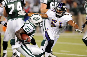 BALTIMORE - AUGUST 24:  Leon Washington #29 of the New York Jets is tackled by Brendon Ayanbadejo #51 of the Baltimore Ravens during a preseason game at M&T Bank Stadium on August 24, 2009 in Baltimore, Maryland.  (Photo by Greg Fiume/Getty Images)