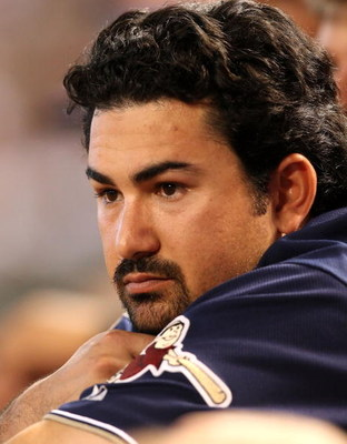 PHOENIX - JULY 08:  Adrian Gonzalez #23 of the San Diego Padres watches from the dugout during the major league baseball game against the Arizona Diamondbacks at Chase Field on July 8, 2009 in Phoenix, Arizona. The Diamondbacks defeated the Padres 6-2.  (
