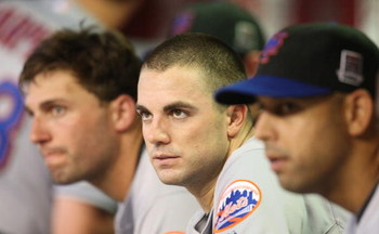 PHOENIX - AUGUST 10: (L-R) Jeff Francoeur #12, David Wright #5 and Alex Cora #3 of the New York Mets look on from the dugout during the game against the Arizona Diamondbacks at Chase Field on August 10, 2009 in Phoenix, Arizona. (Photo by Christian Peters