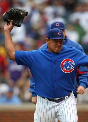 CHICAGO - MAY 27: Starting pitcher Carlos Zambrano #38 of the Chicago Cubs throws his glove into the dugout after being thrown out of a game in the 7th inning against the Pittsburgh Pirates on May 27, 2009 at Wrigley Field in Chicago, Illinois. The Cubs d