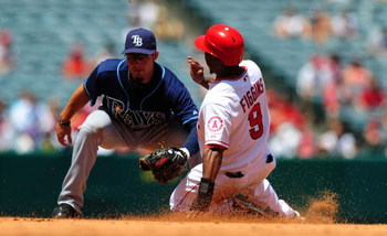 ANAHEIM, CA - AUGUST 12:  Chone Figgins #9 of the Los Angeles Angels steals second base in Major League Baseball action against the Tampa Bay Rays on August 12, 2009 in Anaheim, California.  (Photo by Jacob de Golish/Getty Images)