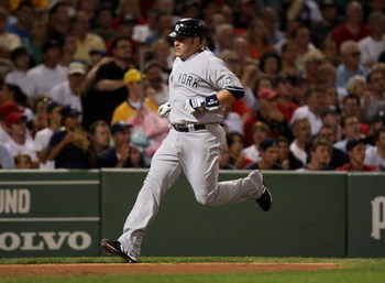 BOSTON - AUGUST 21:  Eric Hinske #14 of the New York Yankees scores a run in the second inning against the Boston Red Sox at Fenway Park on August 21, 2009 in Boston, Massachusetts. (Photo by Jim Rogash/Getty Images)