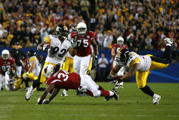 TAMPA, FL - FEBRUARY 01:  James Harrison #92 of the Pittsburgh Steelers runs back an interception for 100 yards to score a touchdown in the second quarter against Tim Hightower #34 of the Arizona Cardinals during Super Bowl XLIII on February 1, 2009 at Ra