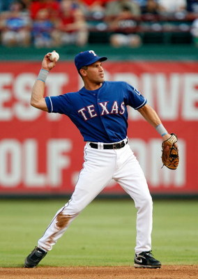 ARLINGTON, TX - JULY 31:   Omar Vizquel #13 of the Texas Rangers on July 31, 2009 at Rangers Ballpark in Arlington, Texas.  (Photo by Ronald Martinez/Getty Images)