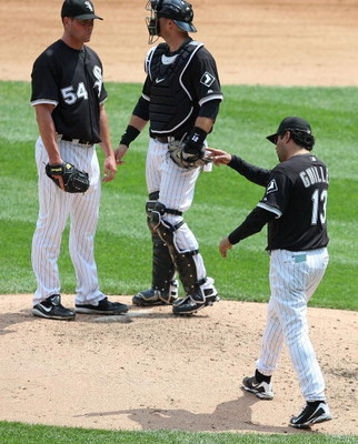 CHICAGO - JUNE 08: Manager Ozzie Guillen #13 of the Chicago White Sox calls for a relief pitcher as he removes starting pitcher Clayton Richard #54 from a game against the Detroit Tigers as A.J. Pierzynski #12 looks to the bullpen on June 8, 2009 at U.S.