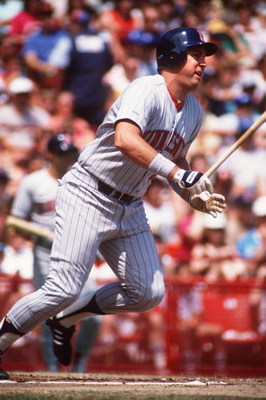 UNDATED:  MINNESOTA FIRST BASEMAN KENT HRBEK LEAVES THE PLATE FOLLOWING A HIT DURING THE TWINS GAME VERSUS THE CHICAGO WHITE SOX. Mandatory Credit: Jonathan Daniel/ALLSPORT