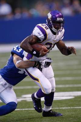 INDIANAPOLIS, IN - AUGUST 14: Running back Adrian Peterson #28 of the Minnesota Vikings runs with the football against the Indianapolis Colts at Lucas Oil Stadium on August 14, 2009 in Indianapolis, Indiana. (Photo by Scott Boehm/Getty Images)