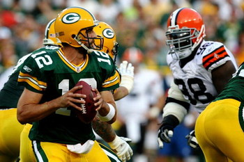 GREEN BAY, WI - AUGUST 15:  Quarterback Aaron Rodgers #12 of the Green Bay Packers looks to pass against the Cleveland Browns during the preseason game at Lambeau Field on August 15, 2009 in Green Bay, Wisconsin.  (Photo by Jonathan Daniel/Getty Images)