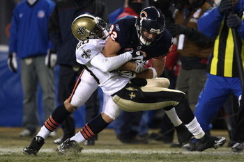 CHICAGO - DECEMBER 11:  Greg Olsen #82 of the Chicago Bears makes a recpetion against Randall Gay #20 of the New Orleans Saints at Soldier Field on December 11, 2008 in Chicago, Illinois. The Bears won 27-24. (Photo by Jonathan Daniel/Getty Images)