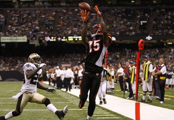NEW ORLEANS - AUGUST 14:  Wide receiver Chris Henry #15 of the Cincinnati Bengals catches the ball in the end zone for a touchdown against Jason David #29 of the New Orleans Saints during the preseason game on August 14, 2009 at the Superdome in New Orlea