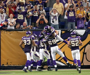 MINNEAPOLIS - SEPTEMBER 21:  Cornerback Antoine Winfield #28 of the Minnesota Vikings celebrates with the defensive unit after scoring a touchdown following his sack and fumble recovery against the Carolina Panthers at the HH Humphrey Metrodome on Septemb