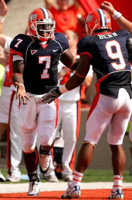 CHAMPAIGN, IL - OCTOBER 06:  Juice Williams #7 of the Illinois Fighting Illini celebrates scoring a touchdown with teammate Arrelious Benn #9 against the Wisconsin Badgers October 6, 2007 at Memorial Stadium in Champaign, Illinois.  (Photo by Matthew Stoc