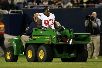 CHICAGO - AUGUST 22: Jay Alford #93 of the New York Giants is taken off the field on a cart after he was injured against the Chicago Bears during their preseason NFL game at Soldier Field on August 22, 2009 in Chicago, Illinois.  (Photo by Jonathan Daniel