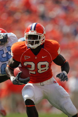 CLEMSON, SC - SEPTEMBER 23:  C.J. Spiller #28 of the Clemson Tigers runs runs with the ball as the Clemson Tigers host visiting University of North Carolina Tar Heels during their game on September 23, 2006 at Memorial Stadium in Clemson, South Carolina.