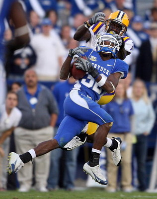 LEXINGTON, KY - OCTOBER 13:  Trevard Lindley #32 of the Kentucky Wildcats intercepts a pass intended for Brandon LaFell #1 of the LSU Tigers during the SEC game at Commonwealth Stadium October 13, 2007 in Lexington, Kentucky. Kentucky won 43-37.  (Photo b