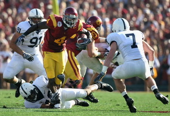 PASADENA, CA - JANUARY 01:  Runningback Joe McKnight #4 of the USC Trojans rushes the ball during the 95th Rose Bowl Game presented by Citi against the Penn State Nittany Lions at the Rose Bowl on January 1, 2009 in Pasadena, California. The Trojans defea