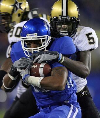 LEXINGTON, KY - NOVEMBER 15: E.J. Adams #17 of the Kentucky Wildcats is tackled by Myron Lewis #5 of the Vanderbilt Commodores during the game on November 15, 2008 at Commonwealth Stadium in Lexington, Kentucky.  (Photo by Andy Lyons/Getty Images)