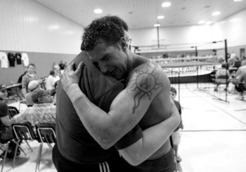 ELDON - JULY 8: Mike (right) and hugs his father Teddy DiBiase after winning his first professional fight for the World League Wrestling on July 8, 2006 in Eldon, Missouri. They trained at the Harley Race Wrestling Academy. Harley Race's legendary wrestli