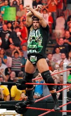 LAS VEGAS - AUGUST 24:  Wrestler Triple H gestures to the crowd during the WWE Monday Night Raw show at the Thomas & Mack Center August 24, 2009 in Las Vegas, Nevada.  (Photo by Ethan Miller/Getty Images)
