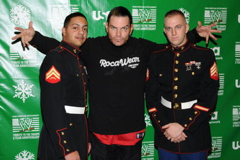 NEW YORK - DECEMBER 18:   (L-R) Marine Cpl. Guilbe, wrestler Jeff Hardy and Marine Sgt. Lahey attend the WWE and USA Network help U.S Marine Corp Toys for Tots Foundation event at the NBC Experience store on December 18, 2007 in New York City.  (Photo by