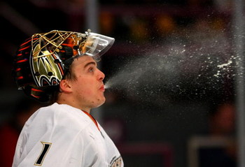 NEW YORK - JANUARY 20: Jonas Hiller #1 of the Anaheim Ducks spits out some water during his game against the New York Rangers on January 20, 2009 at Madison Square Garden in New York City. (Photo by Bruce Bennett/Getty Images)
