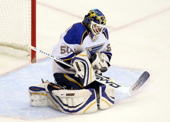 GLENDALE, AZ - APRIL 07:  Goaltender Chris Mason #50 of the St. Louis Blues makes a glove save on a shot from the Phoenix Coyotes during the NHL game at Jobing.com Arena on April 7, 2009 in Glendale, Arizona.  (Photo by Christian Petersen/Getty Images)