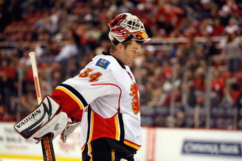 DETROIT - MARCH 12:  Miikka Kiprusoff #34 of the Calgary Flames looks on during the game against the Detroit Red Wings on March 12, 2009 at Joe Louis Arena in Detroit, Michigan. (Photo by Gregory Shamus/Getty Images)