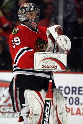 CHICAGO - APRIL 18:  Goalie Nikolai Khabibulin #39 of the Chicago Blackhawks looks on against the Calgary Flames during Game Two of the Western Conference Quarterfinals of the 2009 Stanley Cup Playoffs on April 18, 2009 at the United Center in Chicago, Il