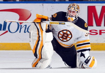 UNIONDALE, NY - APRIL 12:  Tim Thomas #30 of the Boston Bruins looks on against the New York Islanders on April 12, 2009 at Nassau Coliseum in Uniondale, New York. The Bruins won the game 6-2.  (Photo by Jim McIsaac/Getty Images)