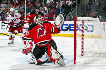 NEWARK, NJ - APRIL 23:  Martin Brodeur #30 of the New Jersey Devils defends his net against the Carolina Hurricanes during Game Five of the Eastern Conference Quarterfinal Round of the 2009 NHL Stanley Cup Playoffs on April 23, 2009 at the Prudential Cent
